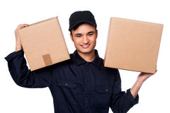 smart-courier-boy-delivering-parcels-young-delivery-work-carrying-carton-boxes-shoulders-31463999